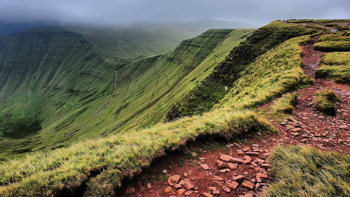 Verdant mountain with clay path in the UK