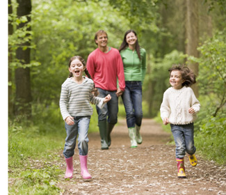 Join us - Family exploring woodland